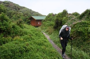 2 leaving hut in rain