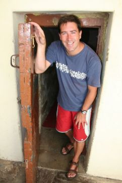 Cathal at cell door of Grahamstown Old gaol