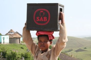 Girl carrying box trad style at Transkei